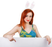 Bunny girl with blank banner. Place for text or theme. royalty free stock photo