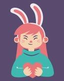 Bunny Girl Holding sveglio un cuore Immagini Stock
