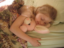 Bunny and girl sleeping royalty free stock photos