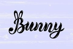 Bunny handwritten lettering with ears. As patch, stick cake topper, laser cut plastic, wooden toppers. Props for First Year Baby Anniversary, Birthday party Royalty Free Stock Photography