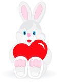Bunny with heart. Bunny holding in the paws of a red heart Stock Photo