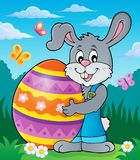 Bunny holding big Easter egg theme 2 Royalty Free Stock Photos