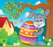 Bunny holding big Easter egg theme 3 Stock Image