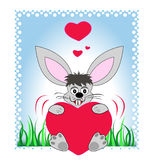 Bunny holding a big heart royalty free stock photography
