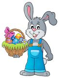 Bunny holding Easter basket theme 1 Royalty Free Stock Photography