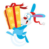 Bunny holding a gift Royalty Free Stock Photography