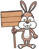 Bunny holding wooden board Stock Photo