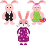 Bunny Illustrations, Eastern Bunnies. Pink eastern boy and girls eastern bunnies with flowers and eastern eggs, green dress, purple dress, rabbits, black vest Royalty Free Stock Images