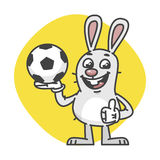 Bunny Laughs Showing Thumbs Up and Holds Soccer Ball Royalty Free Stock Photography