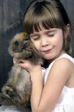 Bunny love. A young girl loving on her baby bunny Stock Photography