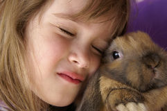 Bunny love. A young girl holding her baby bunny Royalty Free Stock Photos