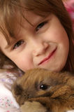 Bunny and me. A young girl holding her baby bunny Stock Photo