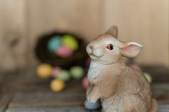 Bunny with out of focused eggs in a nest royalty free stock images