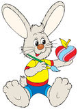 Bunny painting apple like Easter egg. Vector clip-art / funny character for your design Stock Photography
