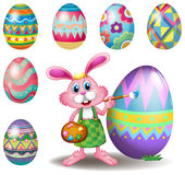 A bunny painting the eggs Stock Photo