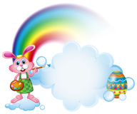 A bunny painting near the rainbow Stock Images