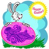 Bunny with patterned easter egg Stock Photo