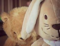 Bunny with sad teddy bear. Plush bunny and teddy bear Stock Images