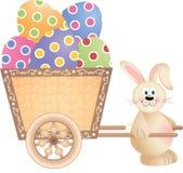 Bunny Pushing Cart Full feliz de los huevos de Pascua Imágenes de archivo libres de regalías