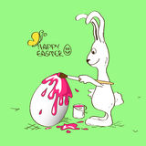 Bunny rabbit coloring Easter egg Stock Images