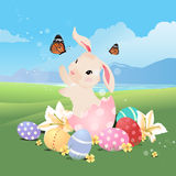 Bunny rabbit in the egg playing with butterfly. Bunny rabbit in the egg playing with butterfly and grass field for Easter Royalty Free Stock Photography