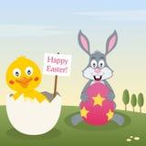 Bunny Rabbit & fågelunge med påskägget Arkivfoto