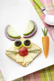 Bunny rabbit made from food with white plate and spoon Royalty Free Stock Photography
