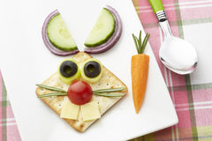 Bunny rabbit made from food with white plate and spoon Stock Photos