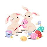 Bunny rabbit painting easter eggs, isolated Stock Photography