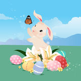 Bunny rabbit playing with butterfly and Easter eggs. Stock Photography