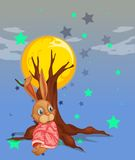 A bunny resting beside the big tree Stock Photos