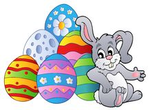 Bunny resting beside Easter eggs Stock Images