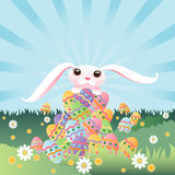 Bunny's Pile of Eggs. The Easter Bunny sits atop his enormous pile of colorful easter eggs Royalty Free Stock Photos