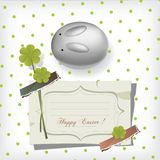 Bunny and shamrocks. Bunny and spring green shamrocks easter retro greeting card Stock Image