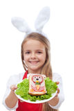 Bunny shaped sandwich presented by little girl Stock Image