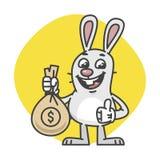 Bunny Showing Thumbs Up e saco do dinheiro Foto de Stock Royalty Free