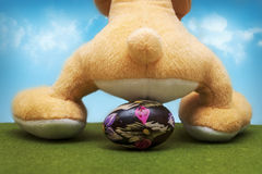 Bunny sitting on an Easter egg Stock Image