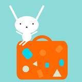 Bunny sitting on a suitcase Royalty Free Stock Photography