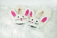 Bunny slippers on white fur Stock Photo