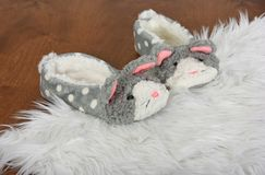Bunny slippers on white fur rug Stock Image
