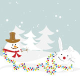 Bunny with a snowman decorated with garlands of fo Royalty Free Stock Photography