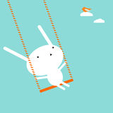 Bunny on a swing royalty free stock image