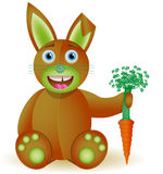 Bunny toy with carrot. Royalty Free Stock Images
