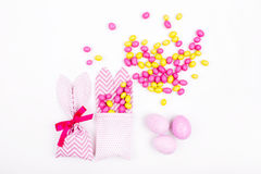 Bunny treat bag with pink candy and eggs on white background;. Easter concept Stock Photo