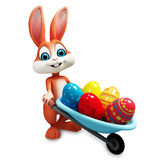 Bunny with trolley full of eggs. 3d rendered illustration of bunny with trolley full of eggs Royalty Free Stock Photos