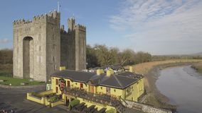 Bunratty Castle and Durty Nelly`s Pub, Ireland - Jan 31st 2017: Aerial view of Ireland`s most famous Castle and Irish Pub. stock video footage
