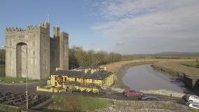 Bunratty Castle and Durty Nelly`s Pub, Ireland - Jan 31st 2017: Aerial view of Ireland`s most famous Castle and Irish Pub. Bunratty Castle and Durty Nelly`s Pub stock footage