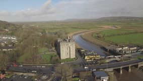 Bunratty Castle and Durty Nelly`s Pub, Ireland - Jan 31st 2017: Aerial view of Ireland`s most famous Castle and Irish Pub. Bunratty Castle and Durty Nelly`s Pub stock video