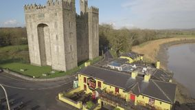 Bunratty Castle and Durty Nelly`s Pub, Ireland - Jan 31st 2017: Aerial view of Ireland`s most famous Castle and Irish Pub. stock video