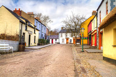 Bunratty cottage town. BUNRATTY, IRELAND - FEB 19: 19th century village street of Bunratty Folk Park, traditional Irish tourist attraction of Co. Clare Stock Images